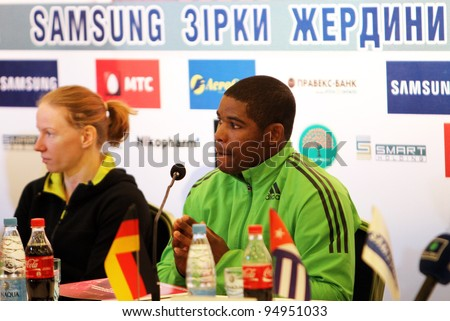 DONETSK, UKRAINE - FEB.11: (R-L) Borges Lázaro and Svetlana Feofanova on the press conference before Samsung Pole Vault Stars meeting on February 11, 2012 in Donetsk, Ukraine.