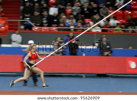 DONETSK,UKRAINE-FEB.11: Rogowska Anna - Polish pole vaulter, bronze medalist of Olympic Games in Beijing in 2008 compete on Samsung Pole Vault Stars meeting on February 11, 2012 in Donetsk, Ukraine.