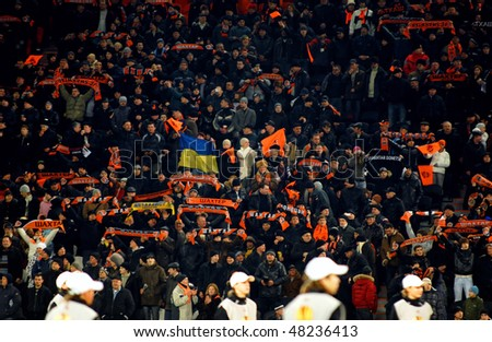 DONETSK, UKRAINE - FEB 25: Shakhtar team supporters watch the match UEFA Europa League between FC Shakhtar(UKR) vs. Fuham FC(ENG) at Donbass Arena stadium February 25, 2010 in Donetsk, Ukraine.