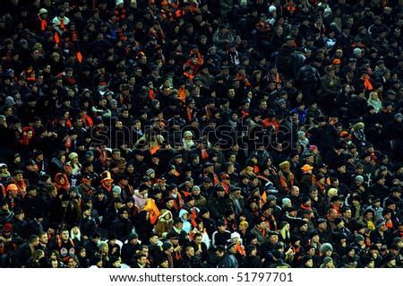 DONETSK, UKRAINE - FEB 25: supporters watch the match UEFA Europa League between FC Shakhtar(UKR) vs. Fuham FC(ENG) at Donbass Arena stadium February 25, 2010 in Donetsk, Ukraine. - stock photo