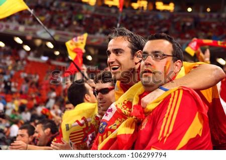 DONETSK, UKRAINE - 27 JUNE 2012: Spanish football fans support their national team on the semifinal match Spain - Portugal. Donetsk, Donbass Arena. EURO 2012 in Ukraine, 27 june 2012