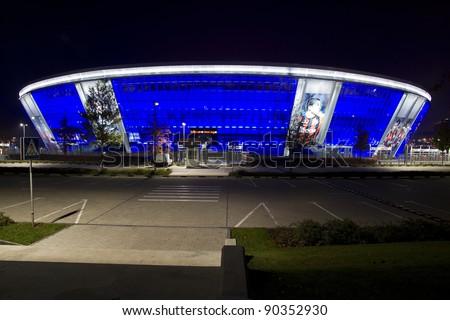 "DONETSK, UKRAINE - OCTOBER 15 - ""DONBAS ARENA"" soccer stadium in Donetsk by night. The stadium will host matches of UEFA Euro 2012. Donetsk, October 15, 2011. - stock photo"