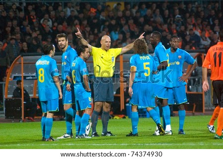 DONETSK, UKRAINE - OCTOBER 1:    FC Barcelona players arguing with referee during the match of Champions League vs FC Shakhtar  on October 1, 2008 in Donetsk, Ukraine