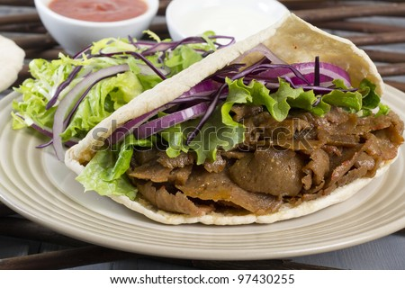 Donner Kebab - Turkish donner meat in a pitta bread served with chilli sauce, garlic mayonnaise and crunchy salad.