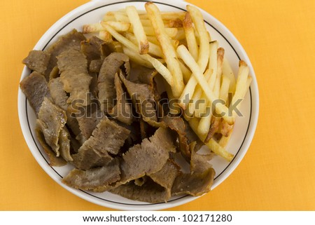 Donner Meat and Chips on a yellow/orange background.