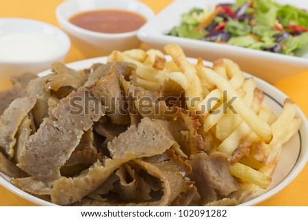 Donner Meat and Chips served with salad, chili sauce and yoghurt/garlic mayo dip.