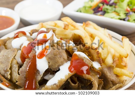 Donner Meat & Chips served with salad, chili sauce and yoghurt or garlic mayo.
