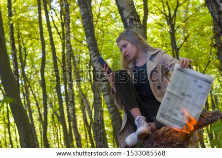 Dont burn forest reads the internet. Protect the environment, save nature and tree reading through smartphone. People choose gadget technology but not newspapers