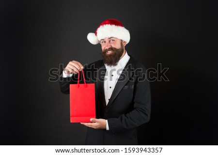 Dont fear finding perfect present. Happy hipster enjoy xmas shopping. Businessman smile with present in paperbag. Present from Santa. Present for Boxing day. Office party. Joy of giving, copy space.