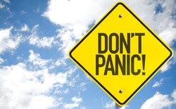 Dont Panic! sign with sky background
