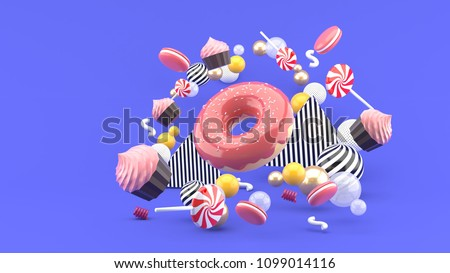 Stock Photo Donut ,Cupcakes ,Macaron,Candy floating among colorful balls on a purple background.-3d render.