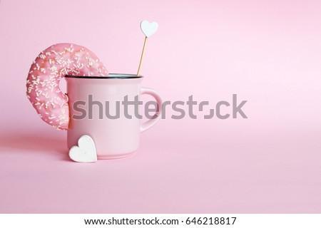 Donut in a pink coffee mug  - Shutterstock ID 646218817
