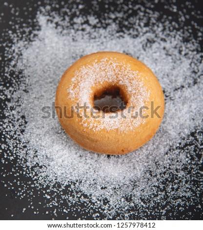 Donut sprinkled with sugar. Donut sprinkled with Granulated sugar