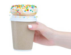 Donut sweet dessert with cardboard cup of coffee in hand on white background isolation