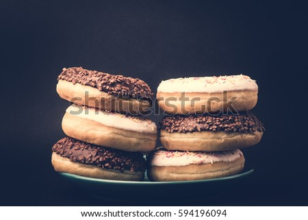 Donut. Sweet icing sugar food. Dessert colorful snack. Glazed sprinkles. Treat from delicious pastry breakfast. Bakery cake. Doughnut with frosting. Baked unhealthy round. #594196094