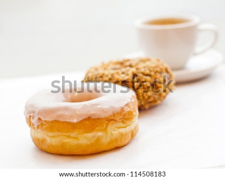 donuts and coffee in the row for a meal