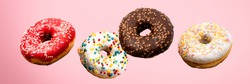 Donuts flying in the air on a pink background. Bakery, baking concept. Levitation. Banner