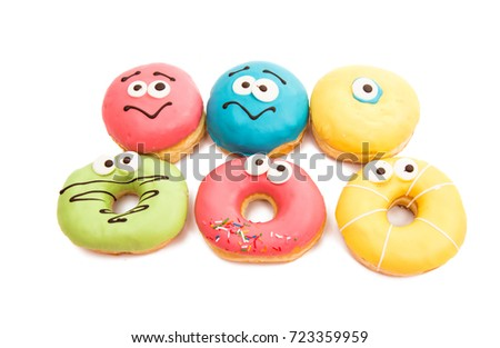 Donuts in glaze isolated on white background #723359959
