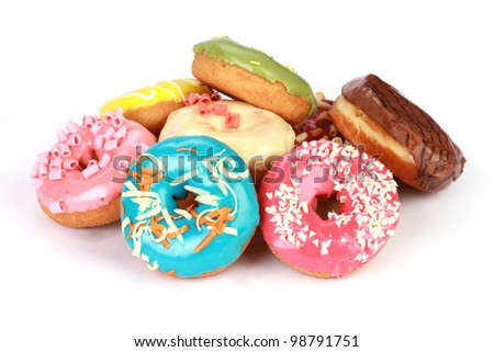 Donuts in stack on white background