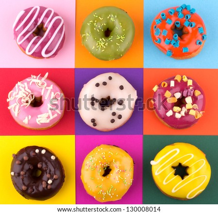 Donuts isolated on colorful background