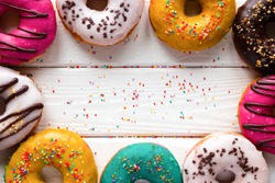 donuts on a wooden background and space for text
