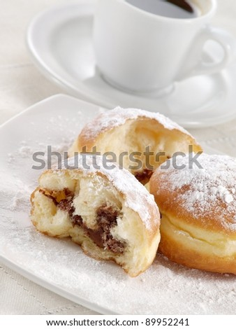 Donuts with chocolate and sugar