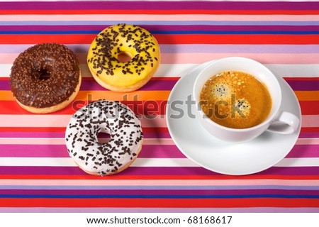 Donuts with cup of coffee