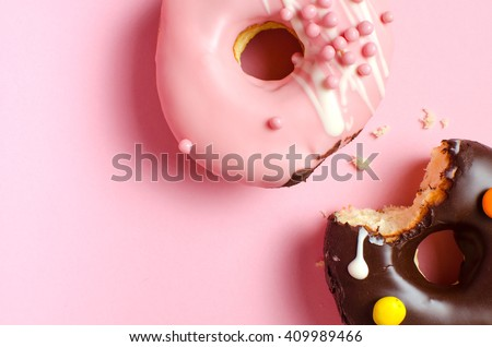 Donuts with icing on pink background. Sweet donuts. Glazed donut.
