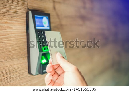 Door access control. Staff holding a key card to lock and unlock door at home or condominium. using electronic card key for access. electronic key and finger scan access control system to unlock doors #1411555505