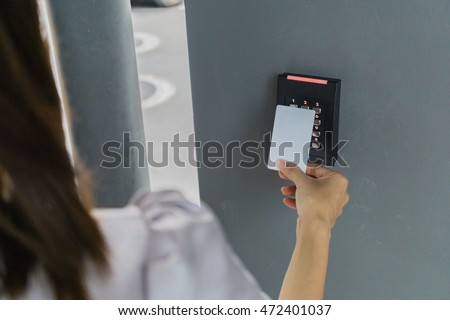 Door access control with a hand inserting key card to lock and unlock door. Security concept.