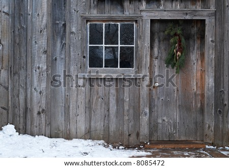 Door and window on an old wooden building