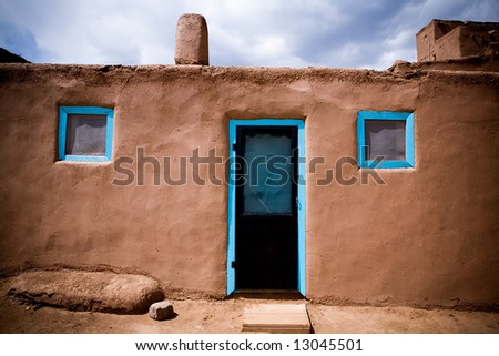 Door and windows in adobe building at Taos Pueblo, New Mexico.
