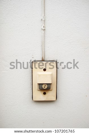 Door bell on white grunge wall