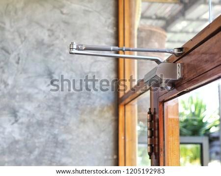 Door closer on modern glass door