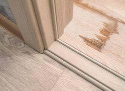 door frame. threshold of a white light interroom wooden door. linoleum