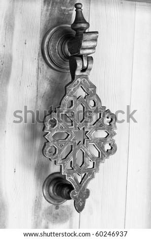 Door handle in Arabic style.