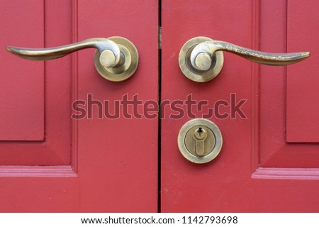 door handles on red wood door #1142793698