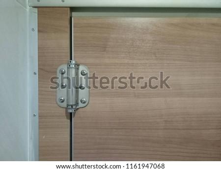 Door hinges in the bathroom. #1161947068