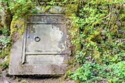 Door into the underground: Iron door of an old rock cellar. These cellars were used to store beer and agricultural products because of the evenly low temperatures (8-12 °C).