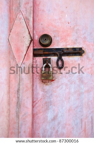 door key lock on red door - stock photo