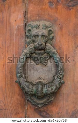 Door knocker in Bologna Emilia Romagna Italy.