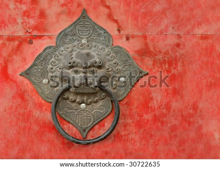 Door knocker on an old Buddhist temple in China