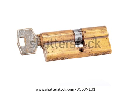 Door lock cylinder core with key, isolated on white background - stock photo