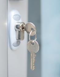 Door lock with keys macro shot - Real estate concept