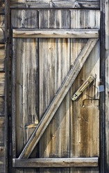 Door made of discoloured pine timber