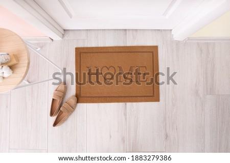 Door mat with shoes in hallway