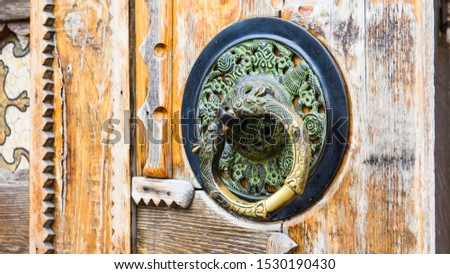 Door metal handle, round handle, old wooden door