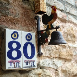 Door number 80 with a rooster figure