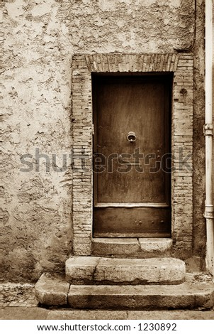 Door of a building in Antibes, France.  Sepia tone, high key.   Copy space.