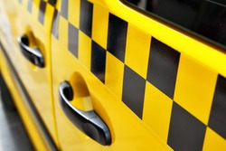 Door of taxi with checker